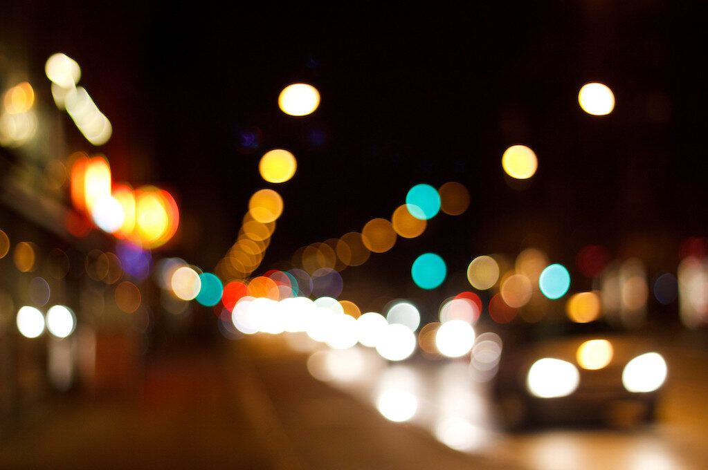 photo of street and traffic lights at night