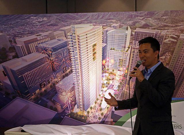 Franco Soberano, Cebu Landmasters Inc. (CLI) executive vice president, (top photo) shows an artist's perspective of their Cebu IT Park project (CDN PHOTO/LITO TECSON).