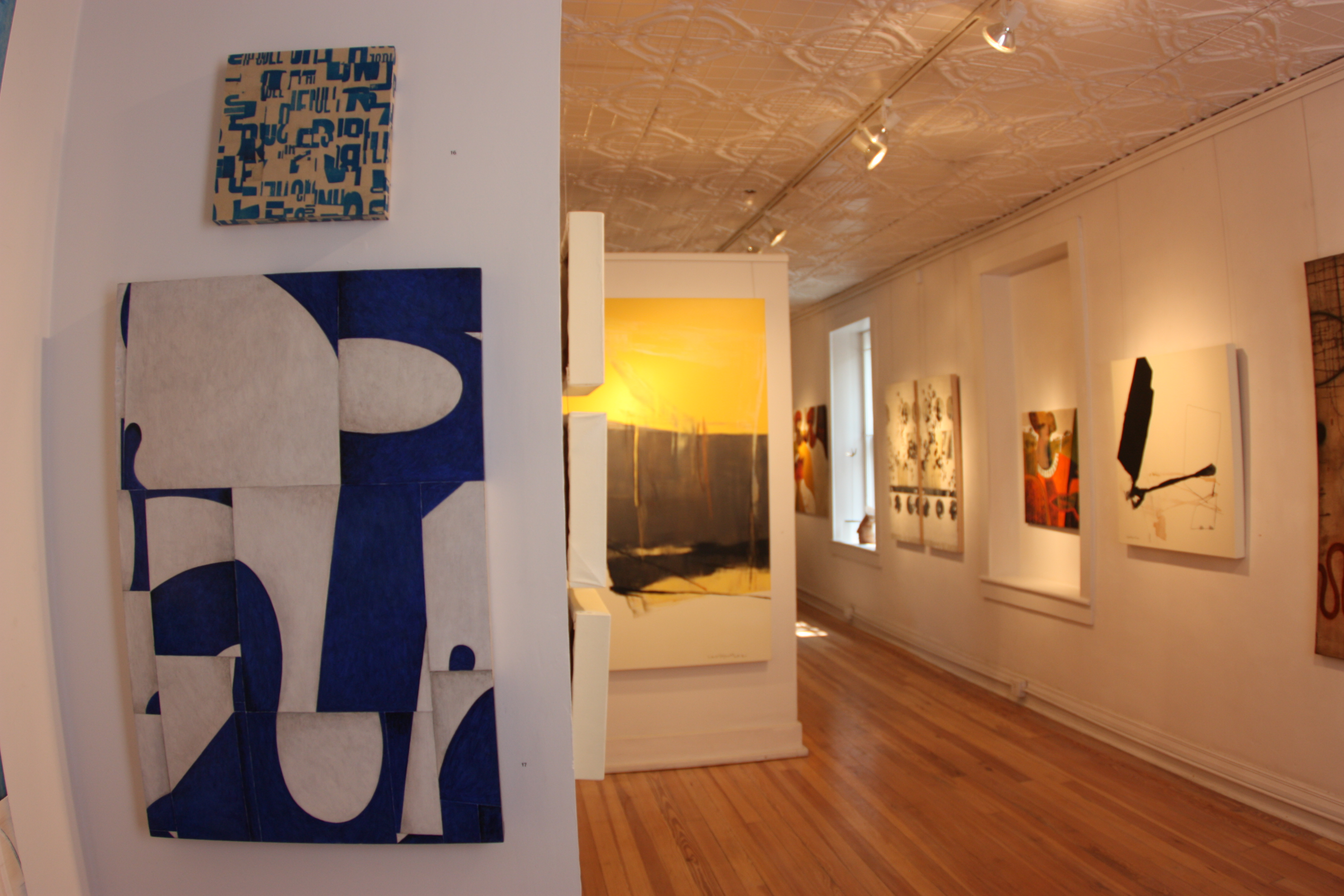 exhibition photo of a painting and a collage by Cecil Touchon at Nuart Gallery in Santa Fe, New Mexico