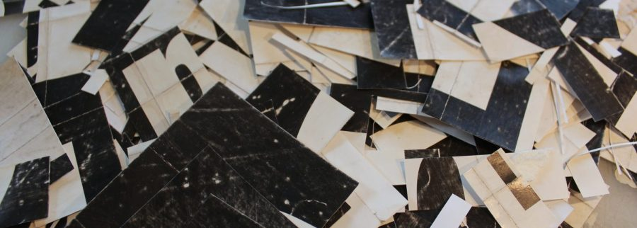 collage materials on Cecil Touchon's work table