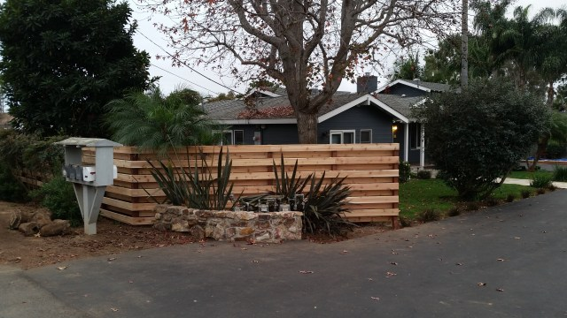 Cedar Deck Boards are installed over 4x4 pressure treated posts to create a beautiful privacy fence