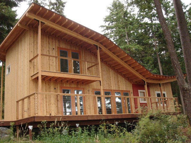Knotty Western Red Cedar Tongue and Groove Siding Cladding installed vertically