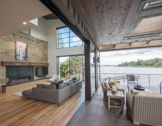 Knotty Cedar Ceilings installed inside the home, as well as outside create a cohesive modern look