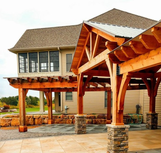 Large Western Red Cedar timbers and beams crate a covered portico and stylish pergola
