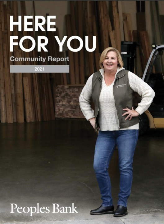 Kym Kelly of Cedar Country Lumber on the front cover of the People's Bank 2021 Community Report