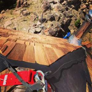Western Red Cedar shakes are being installed to preserve the fire lookout at Mule Peak