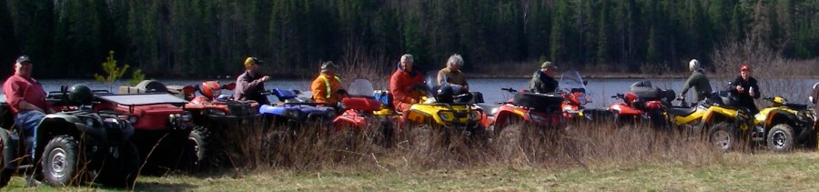 A group of men on an ATV trip large group package accommodations Restoule Ontario ATV trails
