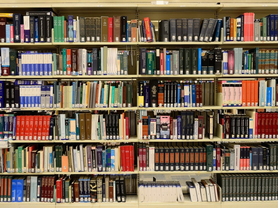 A book shelf in a school library with books in series Cedar Law PLLC An Education Law Firm