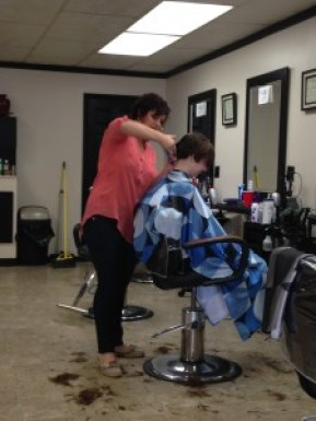 Becca Revenaugh gives Cedarville student Emma Salisbury's hair a pixie cut. (Photo: Kaity Kenniv)