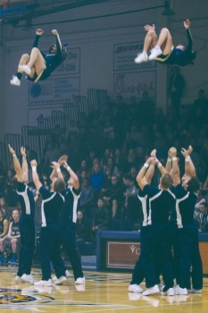 Cheerleaders fly in a basket toss during a halftime routine performed by the Cedarville University cheerleading squad. (Photo: Jillian Philyaw)