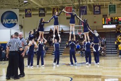 The Jackets' cheerleading team performs stunts during halftime of the men's basketball game. Photo: Kyria Luxon