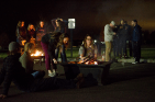 Students roast marshmallows and get warm during the outdoor drive-in movie night Oct. 30.