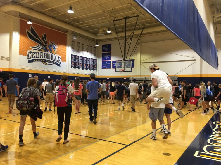 Students rush to receive their free t-shirt at the conclusion of the event.