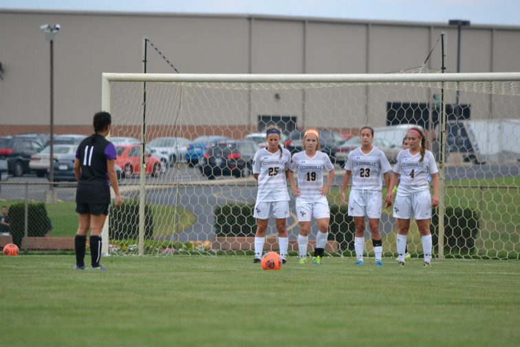 Lady Jackets prepare to defend a free kick. (Photo: Andriana Polsdorfer)