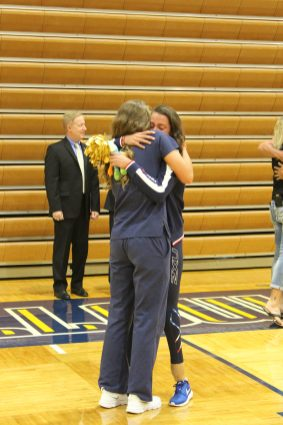 Norman embraces her sister, senior Bethany Norman.