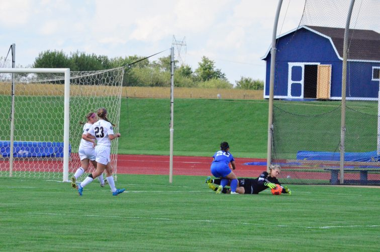 Hanna Harris dives on the ball. (Photo: Allyson Weislogel)