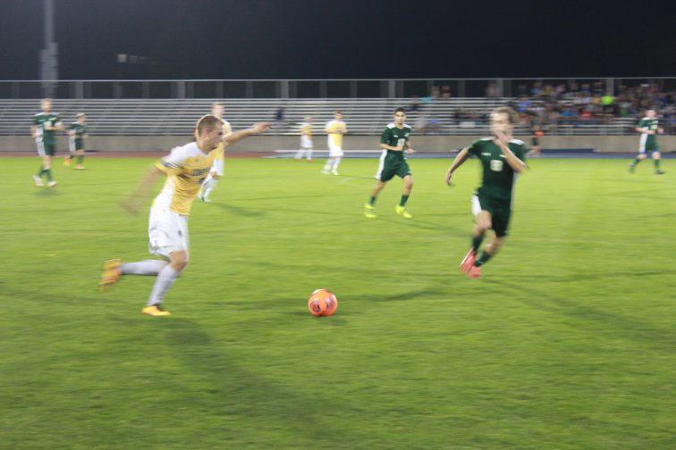 Bradley Schluter prepares to kick the ball up the field. (Photo: Alex Weber)