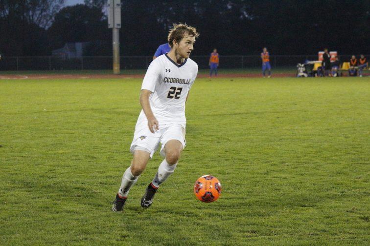 Sean Reilly looks to pass to an open teammate. (Photo: Anna Pizarro)