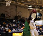 Robert Okoro takes some contact as he goes up for a layup (Photo: Christian Cortes).