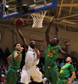 Senior Justice Montgomery takes on three Wilberforce defenders and finishes with a layup (Photo: Christian Cortes).