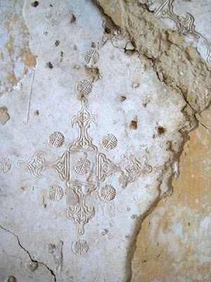 One wall still showed traces of complex plaster reliefs.