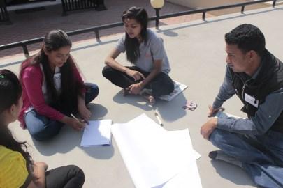 Preparing poster by peer leaders regarding their activities in their communities, challenges, success stories and future plans