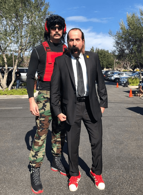 Dr. Disrespect in his gaming attire with one of his friends