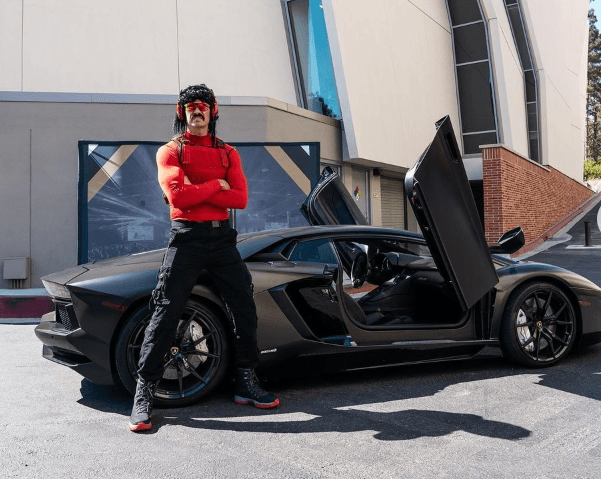 Dr. Disrespect in front of his favorite car