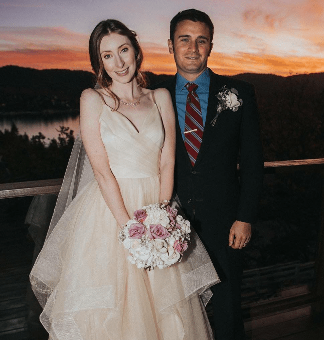 The American model in her wedding gown with husband
