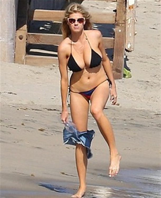 Charlotte McKinney's Tiny Bikini Struggles To Contain Her Boobs