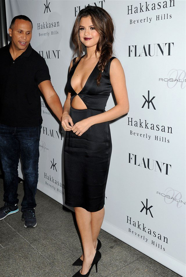 Selena Gomez Shows Deep Cleavage At Flaunt Cover Party