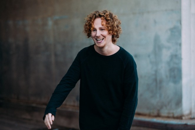 Michael Schulte wearing a black jumper