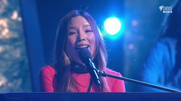 "Dami Im performing ""Marching On"" behind a piano at Eurovision - Australia Decides"