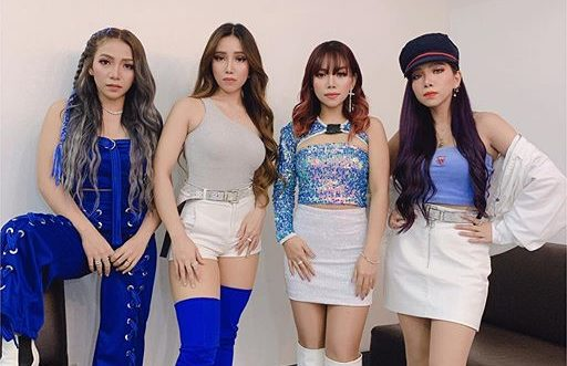 4th Impact posing for a photo, wearing blue