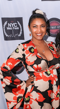 Founder Lauren Atkins at last year's NYC Web Fest, wearing a red, white and black dress.
