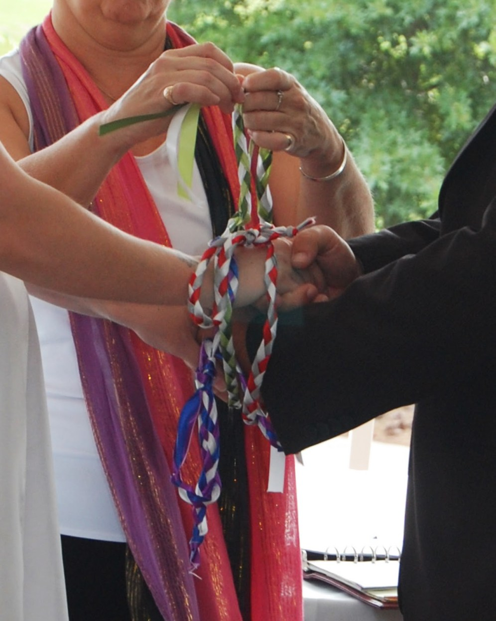 "Handfasting Ceremony - literally ""the ties that bind"" using the Infinity Knot, strong, and resilient"