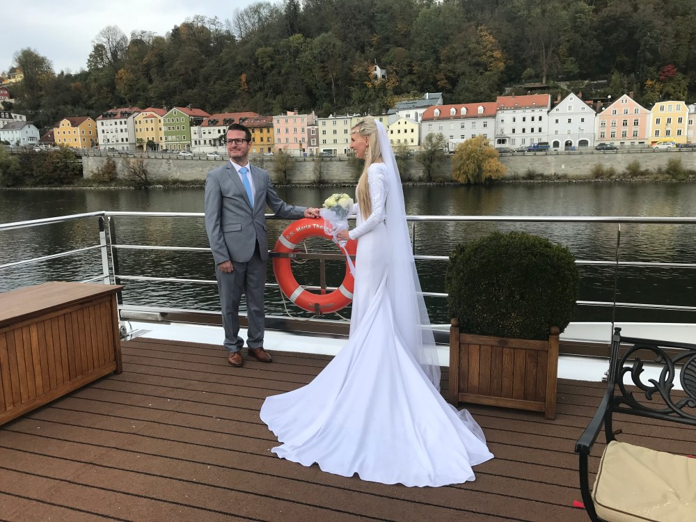 WEDDING COUPLE ON A BOAT ON THE RIVER