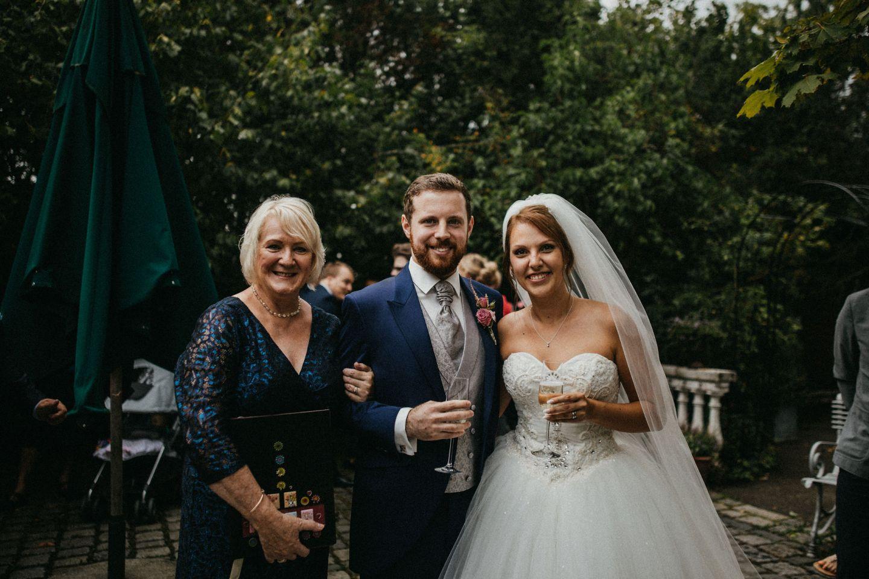 Wedding couple standing with their Wedding Celebrant