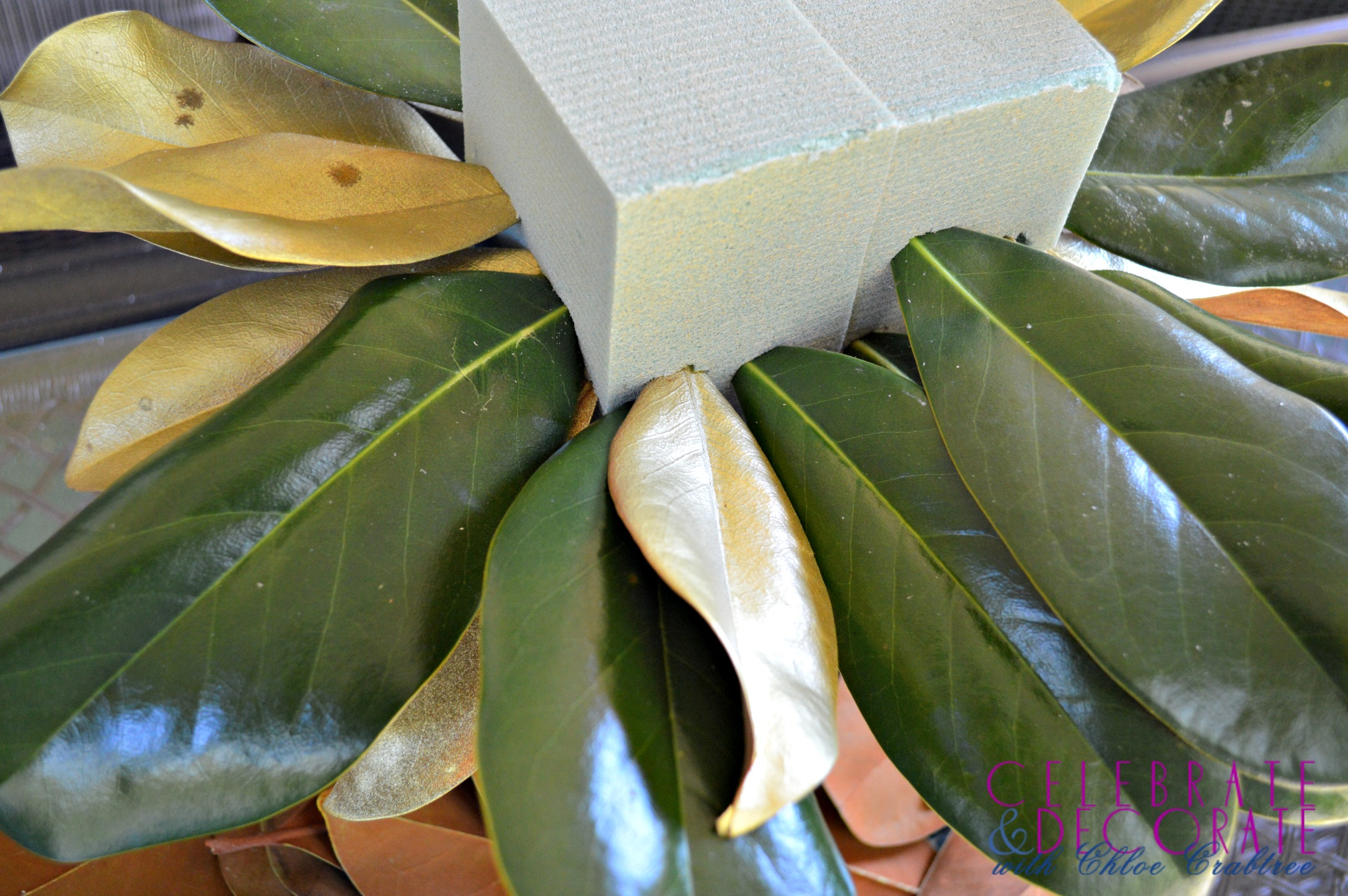 A Fall Centerpiece of Magnolia Leaves and Feathers   Celebrate     Magnolia Centerpiece