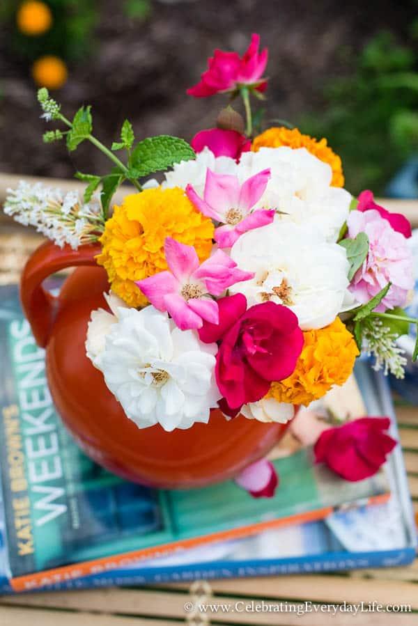 A summer floral arrangement, summer flowers, summer garden florals, garden roses in a pitcher, citrus flowers, orange and pink flower arrangement, Celebrating Everyday Life with Jennifer Carroll