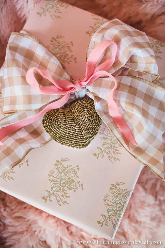 How To Make Your Gifts Look Amazing, Christmas Gift Wrapping Ideas to help your gifts be unforgettable! Pale pink floral, Emma's Floral wrapping paper