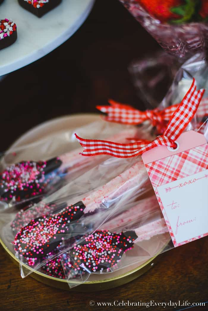 Chocolate Dipped Peppermint Spoons, Sweet treat Valentine's Day buffet, How to Host a Fantastic Galentine's Day Party, How to Host a Fantastic Valentine's Day party, Valentine Party Tips, Valentine Party Ideas, Tips to host the best ever Valentine's Day party!, Tips to host the best ever Galentine's Day party!, What is a Galentine's Day Party? 11 tips to make your Galentine's Day/Valentine's Day party your best party this year!