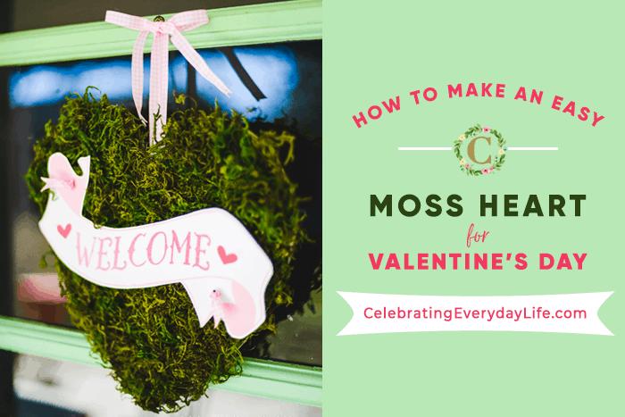 Moss heart Wreath hanging on green door