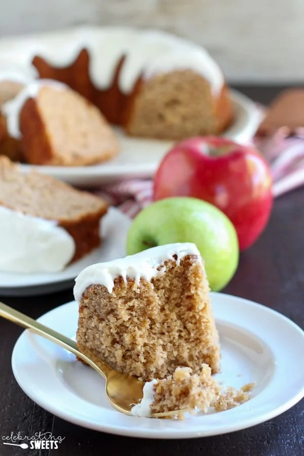 Apple Bundt Cake with Cream Cheese Frosting - A perfectly spiced, tender and moist apple bundt cake. Filled with double the apple flavor from a combination of apple butter and fresh apples. Topped with a thick cream cheese frosting, this apple bundt cake is sure to be a favorite!