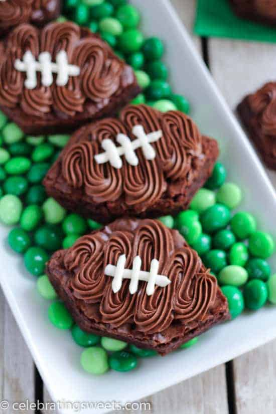 Frosted Football Brownies - Brownies frosted with chocolate and vanilla buttercream to look like a football! No cookie cutter needed for this fun, simple recipe!
