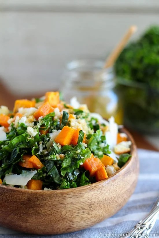 Kale and Sweet Potato Salad - Shredded kale, roasted sweet potatoes, crushed croutons, and shaved parmesan cheese dressed in a lemon-garlic vinaigrette. A healthy meal or side dish.