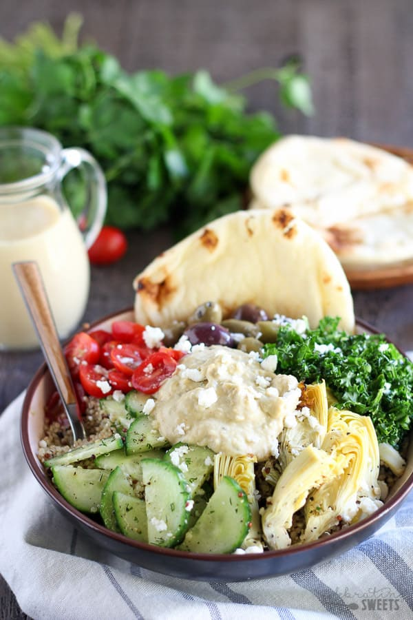 Mediterranean Quinoa and Vegetable Bowls - A vegetable and quinoa bowl filled with Mediterranean flavors - tomatoes, cucumber, artichokes, olives, greens, hummus and feta. An easy, fresh and flavorful meal.