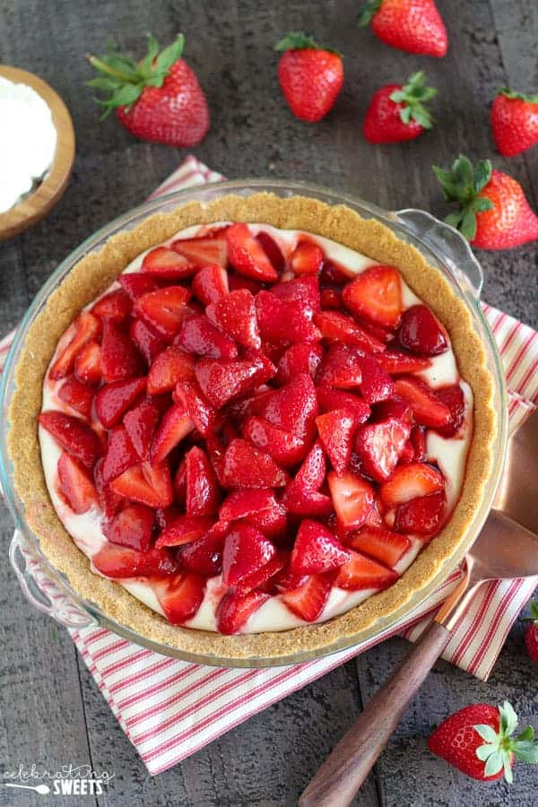 No Bake Fresh Strawberry Cream Cheese Pie - A buttery graham cracker crust filled with sweetened cream cheese and topped with a mountain of juicy fresh strawberries. This gorgeous no-bake pie is the perfect spring or summer dessert.