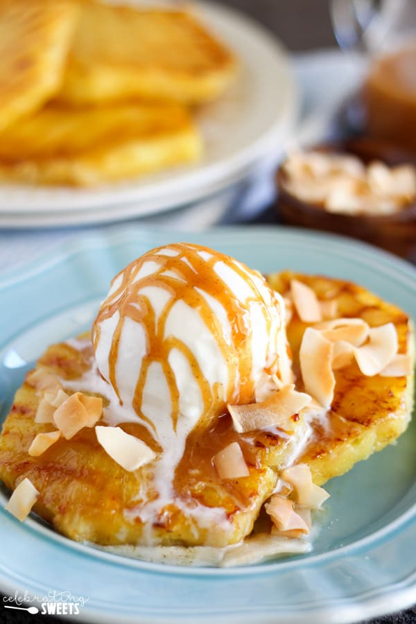 Grilled Pineapple Coconut Sundaes - Juicy grilled pineapple topped with coconut ice cream, caramel sauce and toasted coconut. A light and refreshing summer dessert!