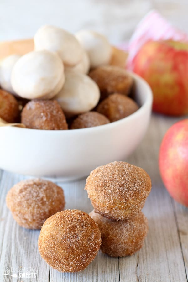 Baked Apple Cider Donut Holes - Baked Donut Holes flavored with apple cider, applesauce, and cinnamon. Roll them in cinnamon sugar or top them with an apple cider glaze. You'll love these better-for-you donuts.